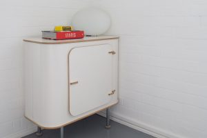 small bedside table from The Conran Shop grey painted floor and Strong White walls from Farrow & Ball
