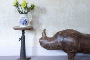 Oxford home study with vintage Singer sewing machine stool and old leather rhino from Omersa Cole & Son Cow Slip wallpaper