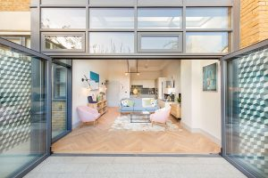 Fulham living dining room interior with hexagon outdoor wall tiles and herringbone oiled wood floor for Verve Properties