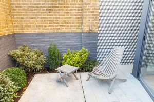 Verve Properties Hunts Paper Factory outdoor courtyard with Mosaic Del Sur cement Granito tiles and Harmen chair and stool