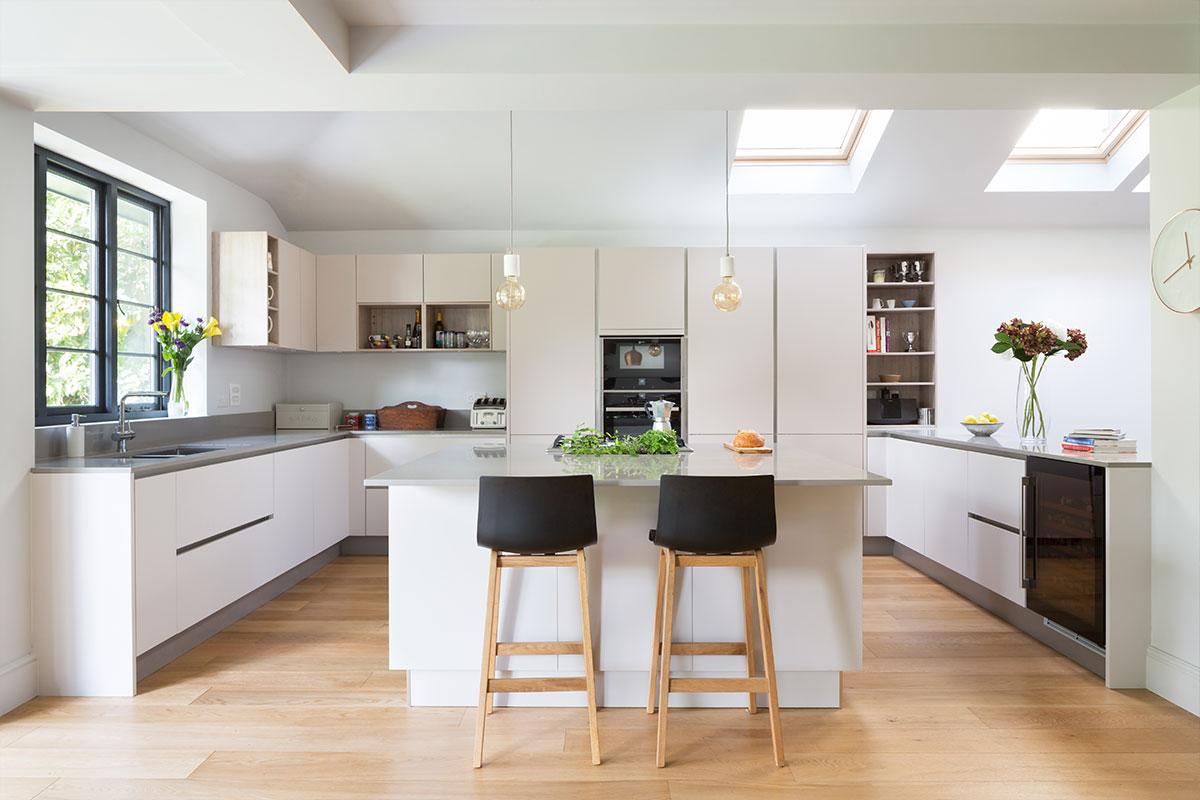 Kochwerk German open-plan kitchen with Bristol pendants from Heals over stone worktop home refurbishment from Element Studios