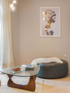 Living room Noguchi coffee table and Scott large round grey leather ottoman from Made with Marianna framed print by Juniqe