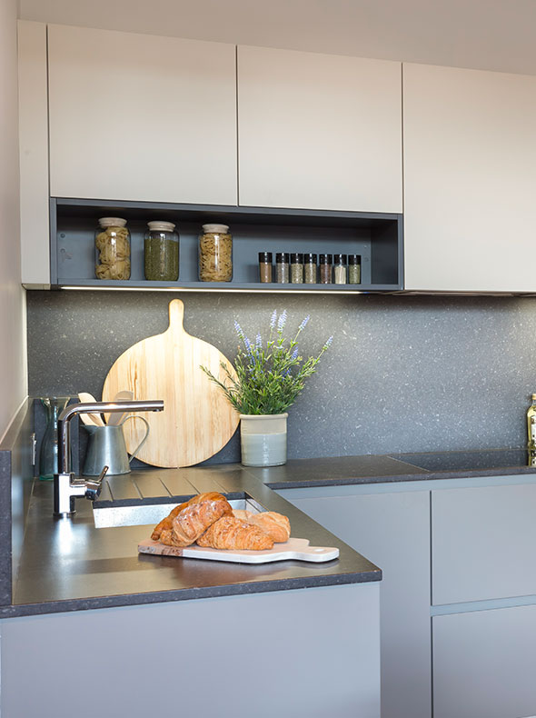 Fulham flat interior for Verve Properties close-up of German kitchen by Kochwerk with stone worktop and wooden chopping board