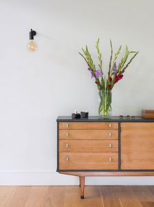 detached house by Oxford interior architects Element Studios vintage mid-century sideboard with Heals Junction wall light