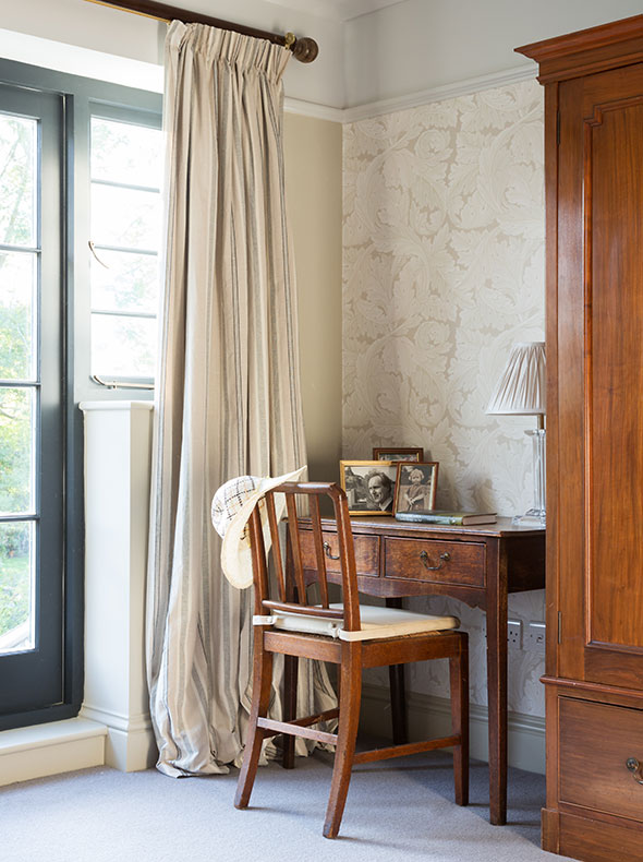 master bedroom showing antique oak desk and chair with Morris & Co Acanthus wallpaper & Drop Cloth matt emulsion on walls