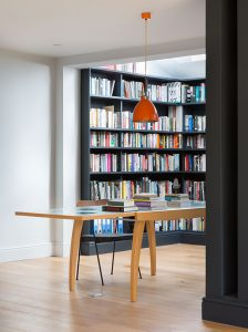 bespoke library designed by Element Studios and painted in Railings with mid-century desk and chair and orange Jielde pendant