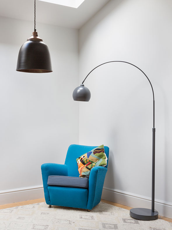 reupholstered preowned chair in Refurbished Oxford home with pendant from Rockett St George and Heals mini lounge floor lamp