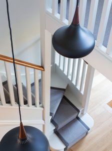 hallway and staircase of refurbished Oxford townhouse with grey carpet runner and Orient P3 pendants from SCP