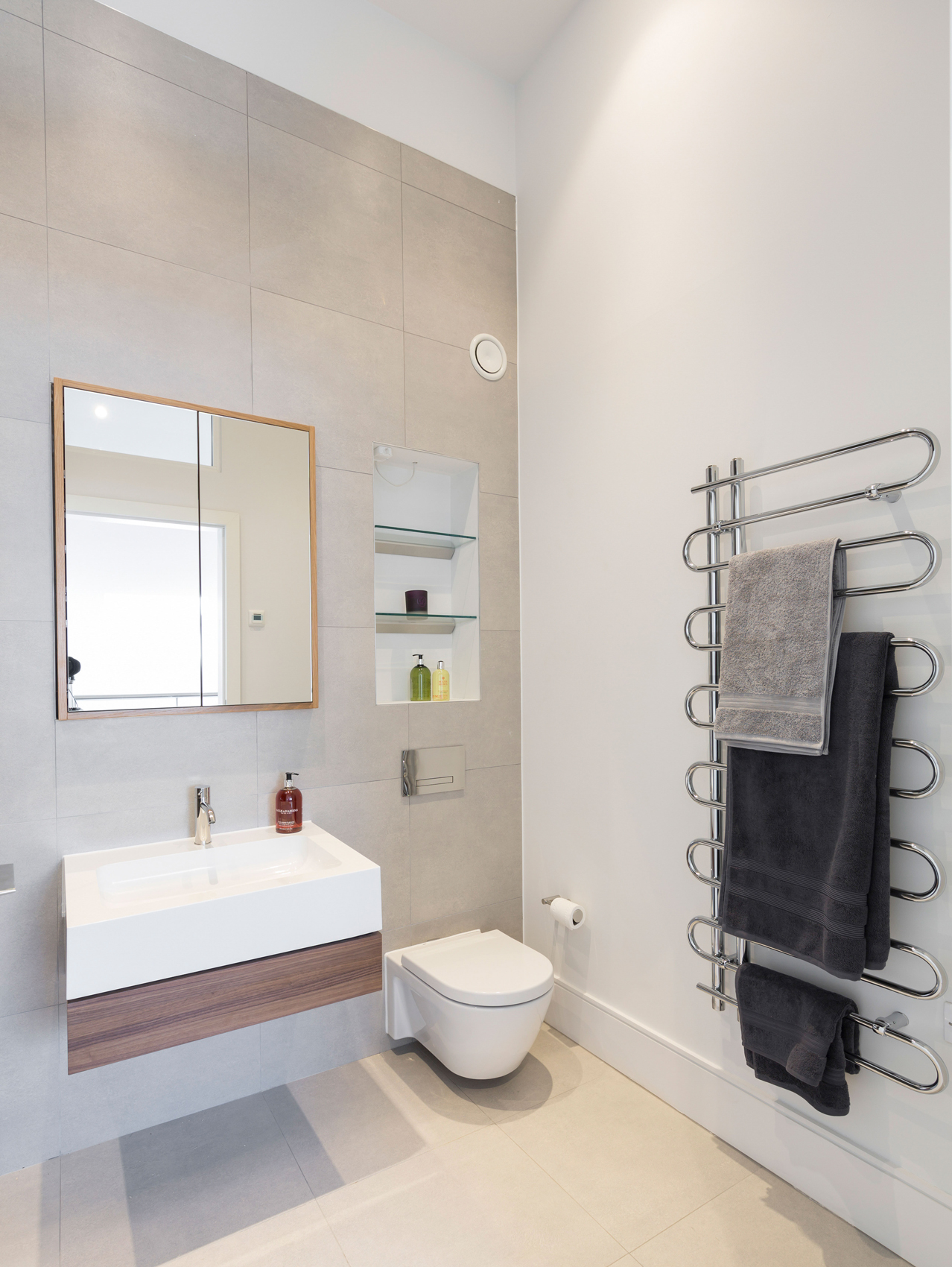 luxury bathroom with recessed shelving and white porcelain bespoke flush mirrored cabinet designed by Element Studios
