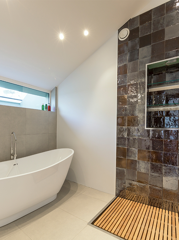 Verve Properties Fulham townhouse freestanding bath with glazed wall tiles and flush timber slatted shower tray