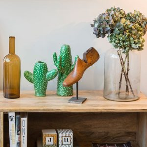 wooden shelf unit with Rockett St George green cactus vase and vintage hardwood shoe stretcher from The Old Cinema London