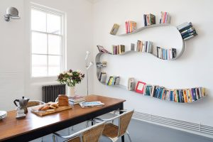 dining room refurbishment of East London flat with Bookworm shelving from the Conran Shop and Jeilde loft flush wall light