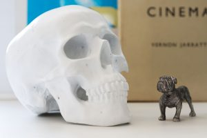 ceramic skull and pewter bulldog ornament interior design of refurbished East London ammunitions factory by Element Studios