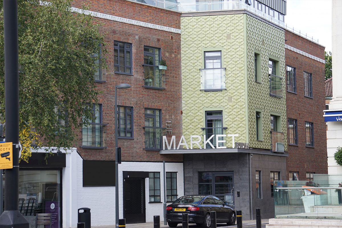 Old Market Building Brentford converted to flats with exterior 1950s style Kaza concrete tiles vine by Gillian Blease