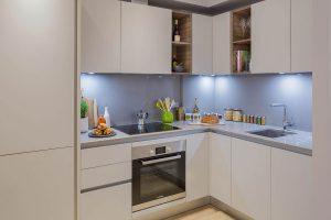 Flat conversion Brentford contemporary German kitchen by Kochwerk light grey stone worktop