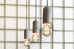refurbished interior of ammunitions factory East London with industrial glass blocks and Nud concrete pendant lights from SCP