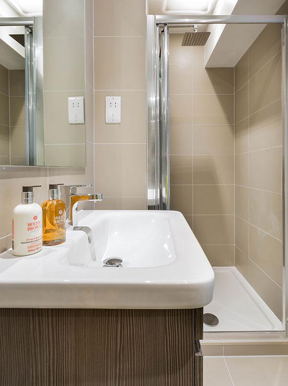interior design by Element Studios of Verve Properties Brentford flat en-suite with Duravit wash basin and walnut vanity unit