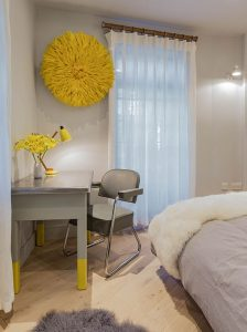 1950s French writing desk with grey tub chair and Juju yellow hat on wall behind bedroom interior design by Element Studios