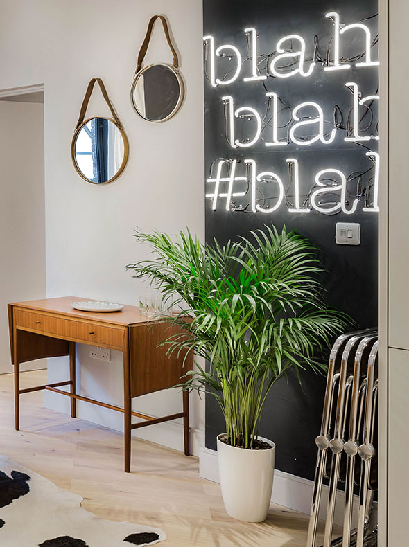 West London contemporary living dining room with vintage drop leaf table from Funky Junky and neon Heals Blah blah blah sign