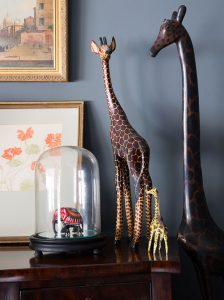vintage dark wood sideboard with wooden animal ornaments and bell jar Farrow & Ball Downpipe emulsion