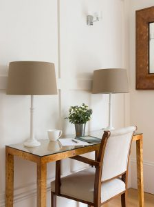 dining room interior with walnut console table and lamps with walnut mirror and painted panelling by Element Studios