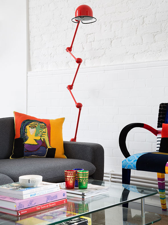 Living room interior with red Jielde floor lamp from Holloways of Ludlow Squint chair and Picasso cushion The Conran Shop