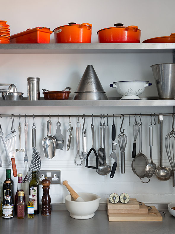 Industrial kitchen in East London with stainless steel worktop and Le Creuset pots by Element Studios interior design
