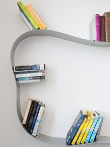 interiors residential refurbishment in East London by Element Studios showing Ron Arad bookworm shelving from Kartell