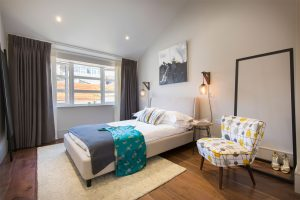 Fulham bedroom with Bartholomew vintage style chair from Galapagos Design and Lume open wardrobe, interior by Element Studios