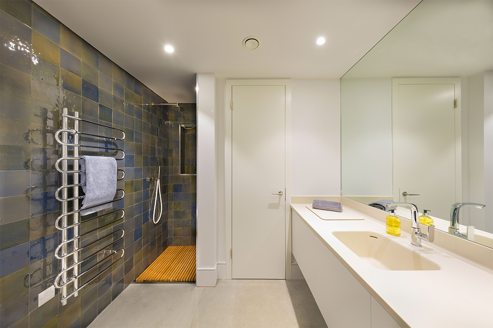 utility by Element with glazed wall tiles and Corian sink unit including shower with flush hardwood timber slatted tray