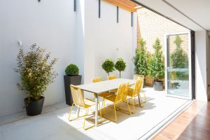 Fulham townhouse renovation by Element enclosed courtyard with Espina garden chairs