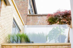Fulham townhouse renovation for Verve Properties by Element Studios with first floor balcony showing a Japanese acer